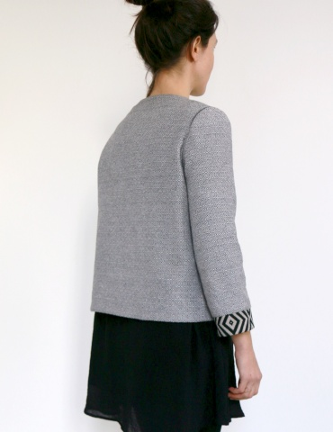 Claudie jacket in black and white thick cotton, with no collar, back view